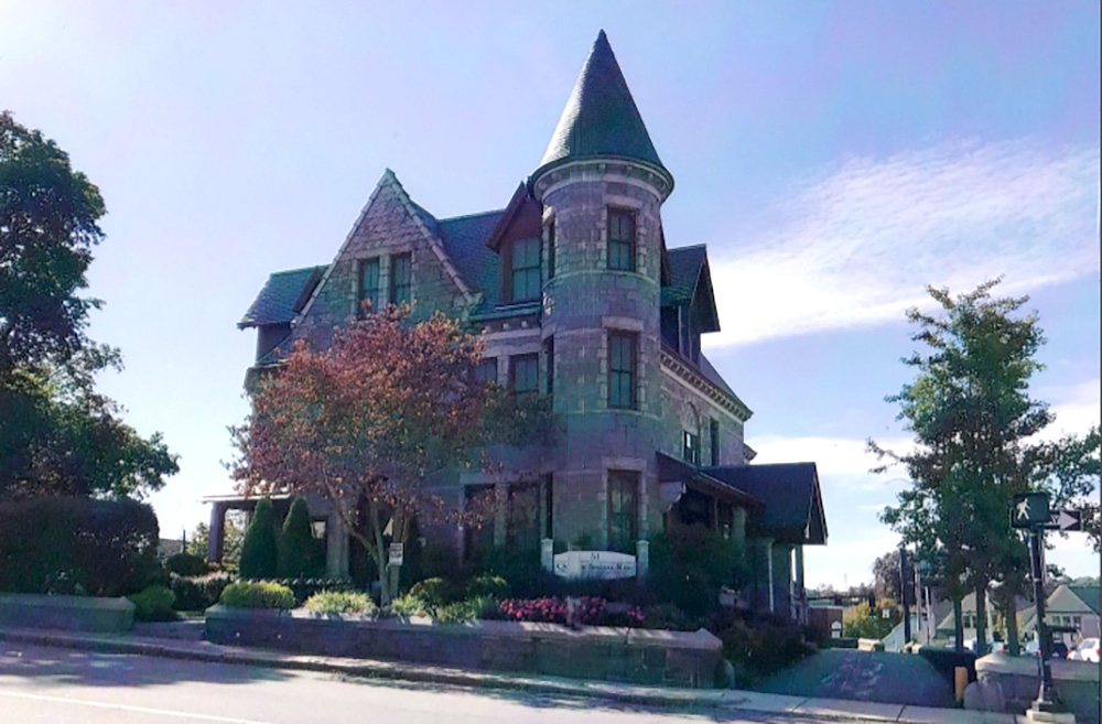 Whitcomb Hall, a three-story granite Victorian mansion